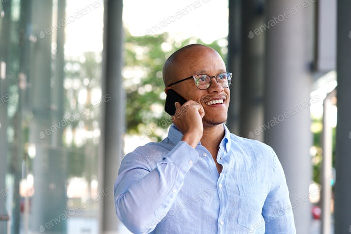 smiling businessman talking on mobile phone