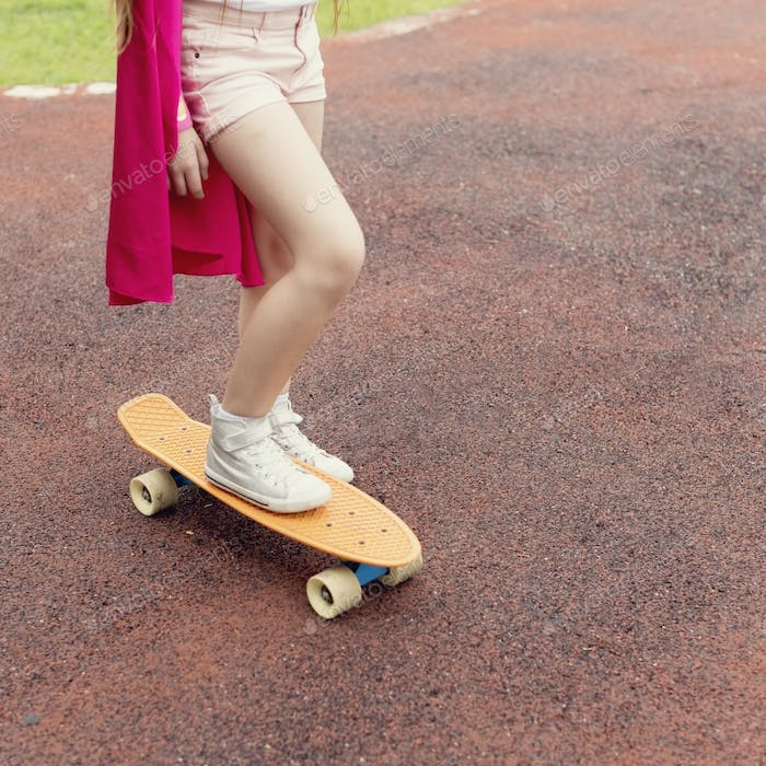 Superhero Girl Playing Skateboard Activity Concept