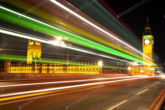 Big Ben London with lights from incoming bus