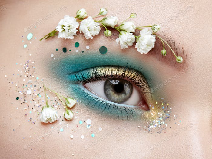 Eye makeup woman with a flowers