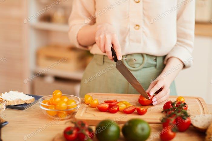 Woman Cooking Healthy Breakfast in Kitchen