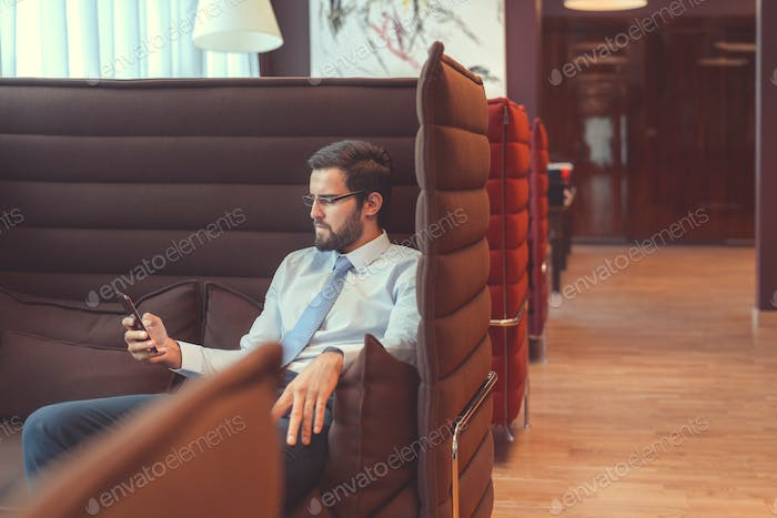 Young businessman with a phone
