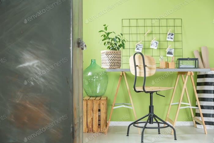 Green room with metal furniture
