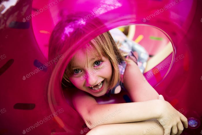 Closeup of caucasian girl with inflatable tube