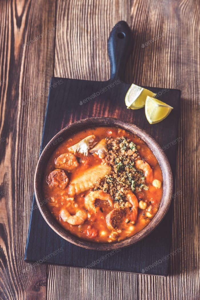 Portion of spanish fish and chorizo soup