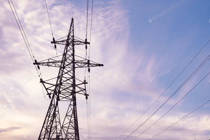 Electricity pylons and cabling, back ligth