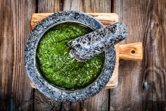 homemade pesto in a mortar