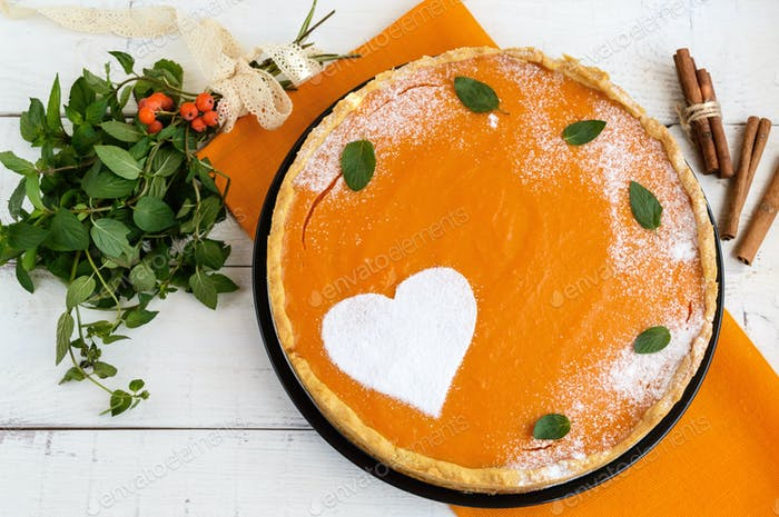 Sweet pumpkin pie on a white background