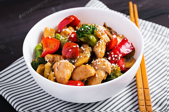 Stir fry with chicken, mushrooms, broccoli and peppers. Chinese food.