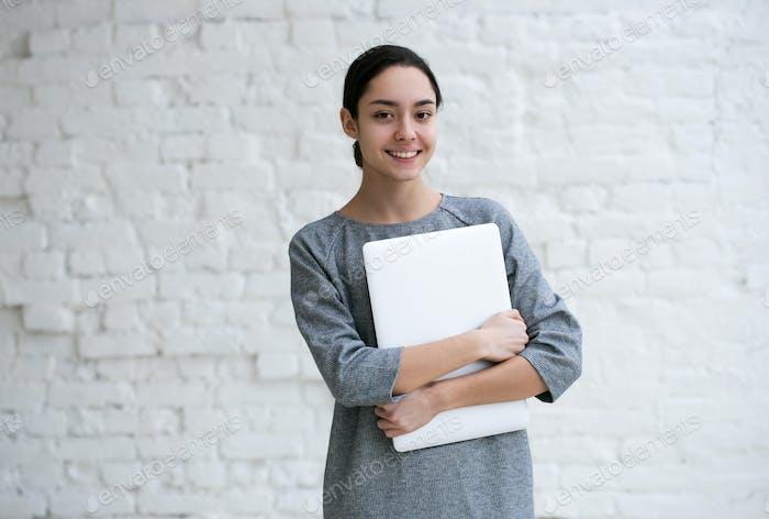 Beautiful Woman with Laptop. Indoor shot.