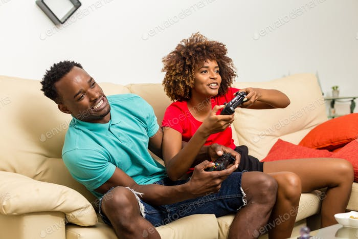 Black African American couple having fun playing video games
