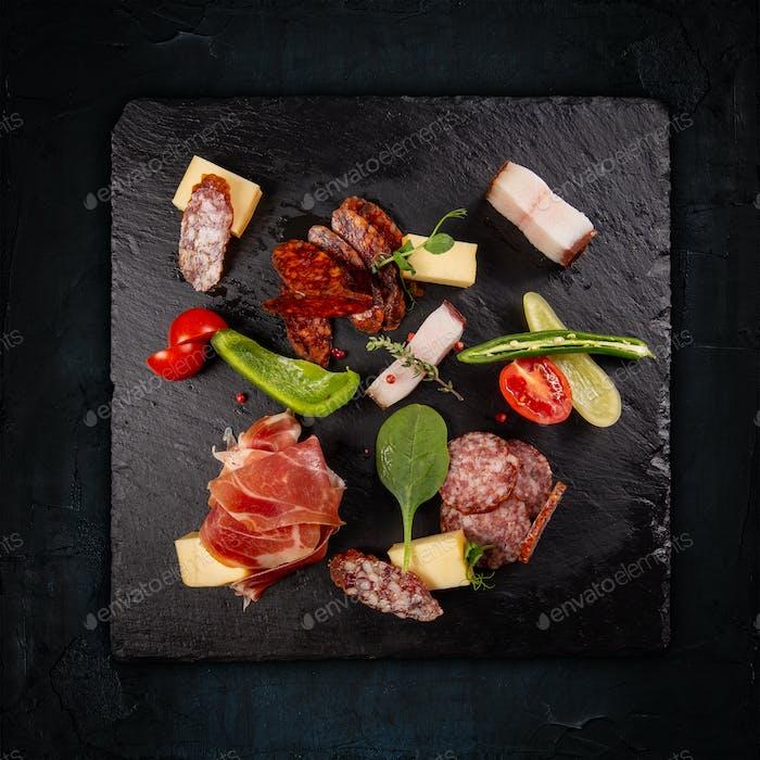 Slate board with prosciutto