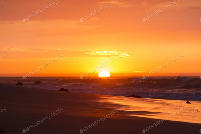 Ocean sunset on the beach and the Pacific Ocean in Mancora, Peru