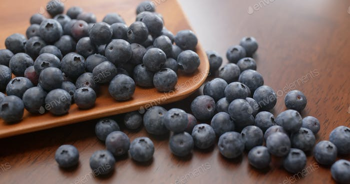 Stack of blueberry on wooden plate