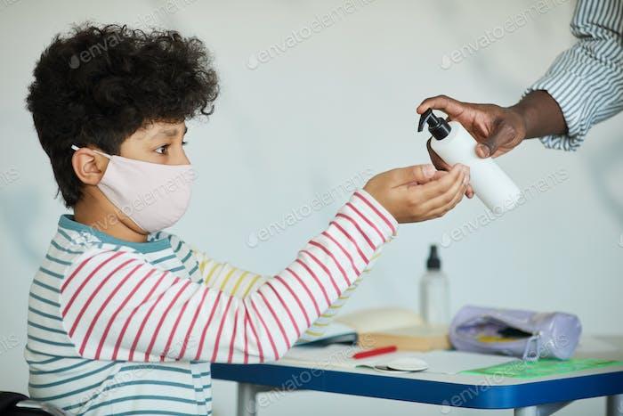 Schoolboy Sanitizing Hands