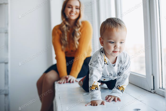 Mother sitting at home with little son