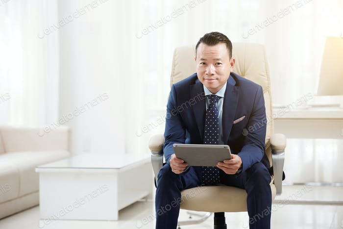 Entrepreneur with tablet computer