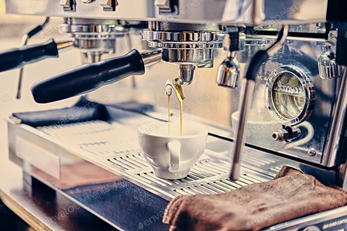 Close up image of professional stainless coffee machine.