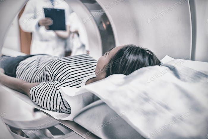 Female patient undergoing CT scan