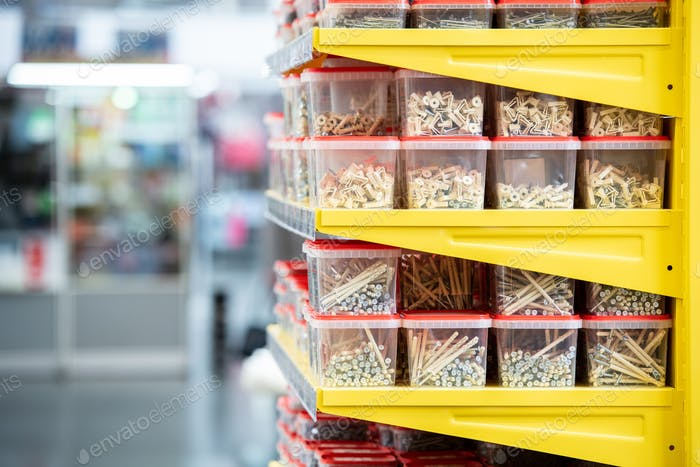 Side view of shelves with stacks of plastic containers