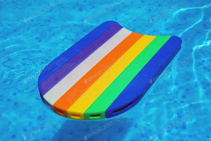 Rainbow pattern styrofoam swimming board baseboard floating in p