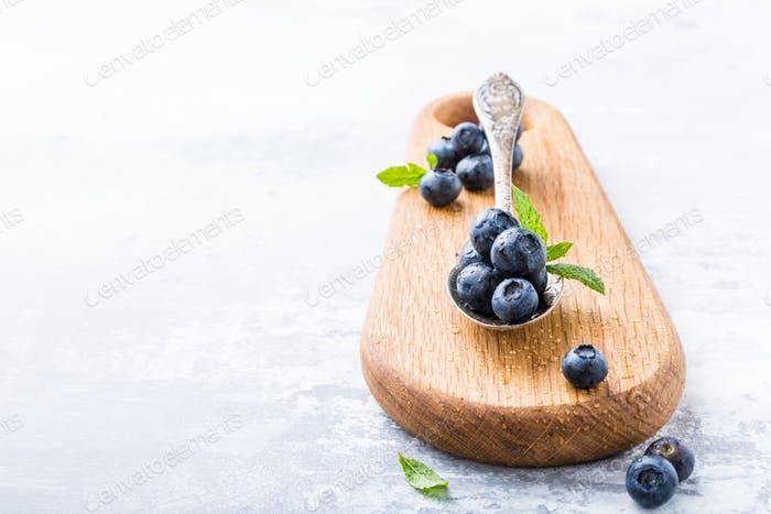 Freshly picked blueberries in vintage spoon