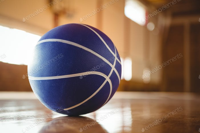 Blue basketball on hardwood floor