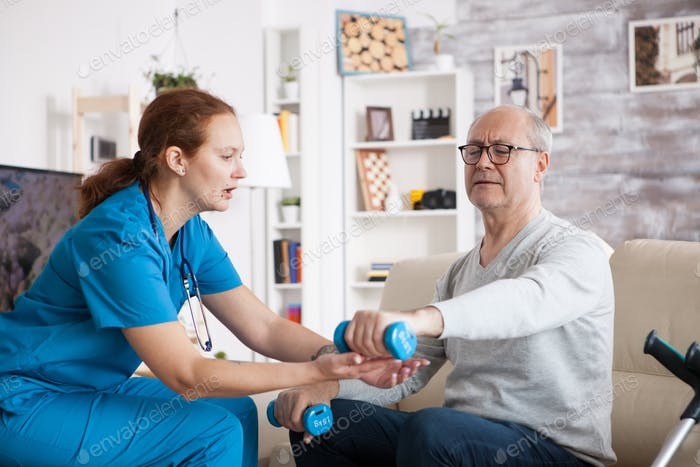 Senior man in nursing home doing physiotherapy