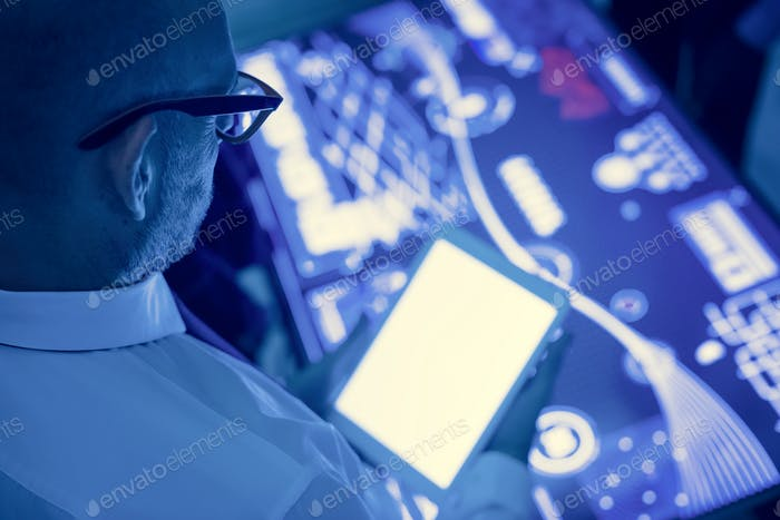 Man holding using tablet in a technology meeting