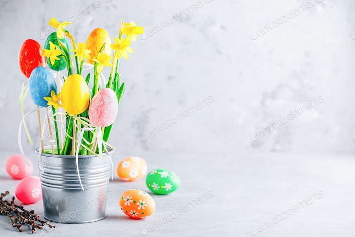 Spring easter daffodils flowers and painted easter eggs