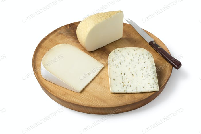 Wooden board with diversity of Dutch goat cheese