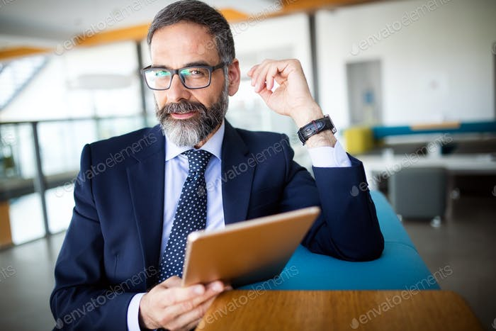 Shot of thinking financial advisor businessman working in office