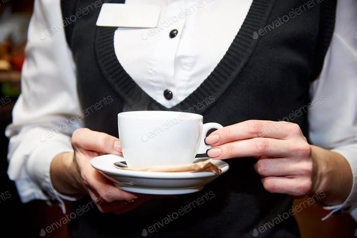 Waiter with a cup of tea