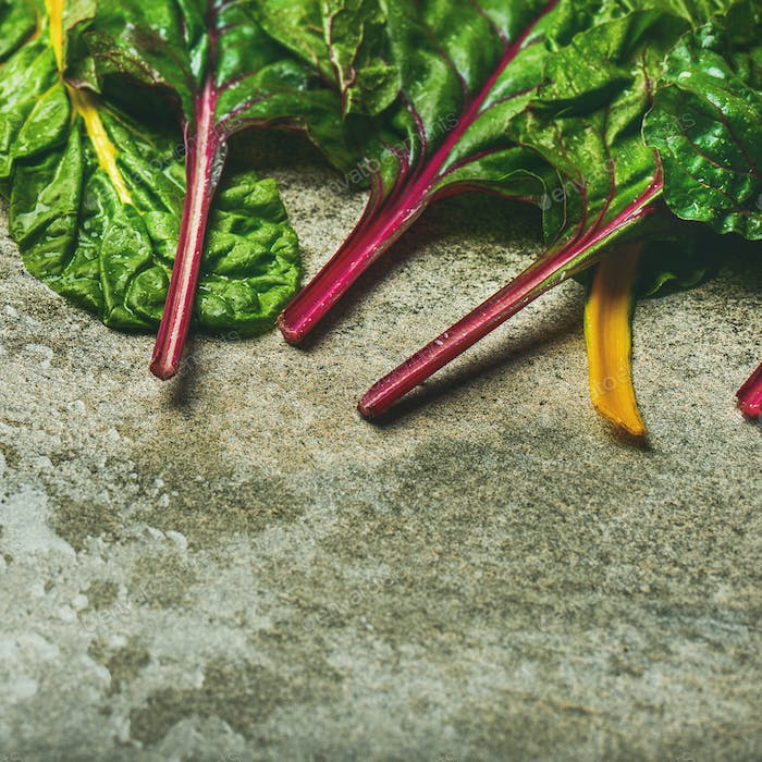 Flat-lay of fresh leaves of swiss chard. Healthy cooking concept