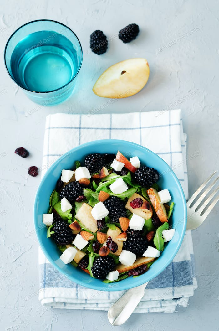 Pear arugula blackberry almond goat cheese dried cranberry salad