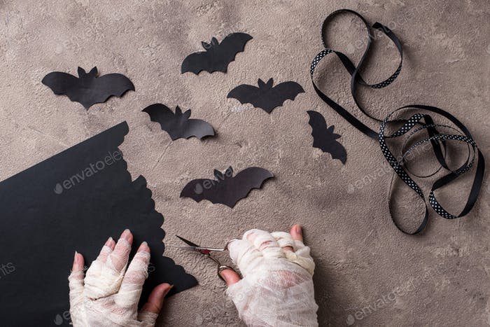 Mummy makes bats out of paper