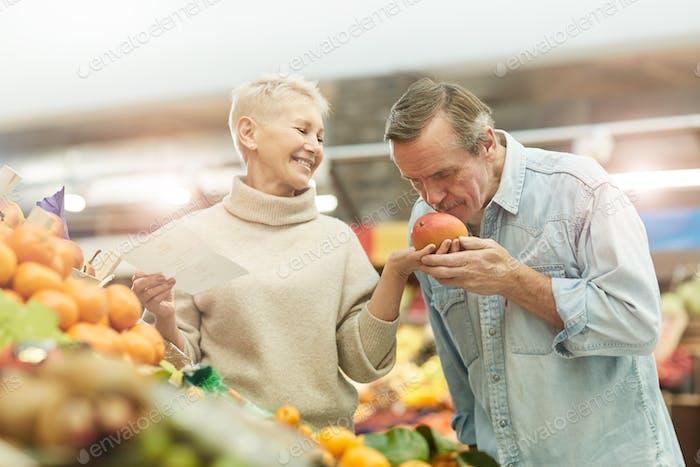 Senior Couple Choosing Fruits at Market