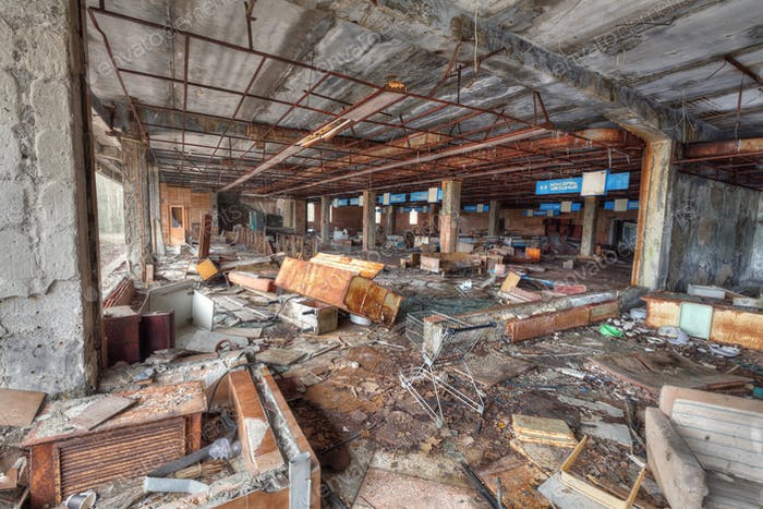 Ruined supermarket in overgrown ghost city Pripyat.