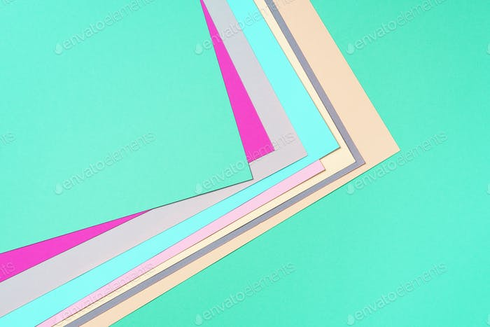 Background in trendy green and pink colors. Fashionable paper. Top view. Minimal concept. Trendy