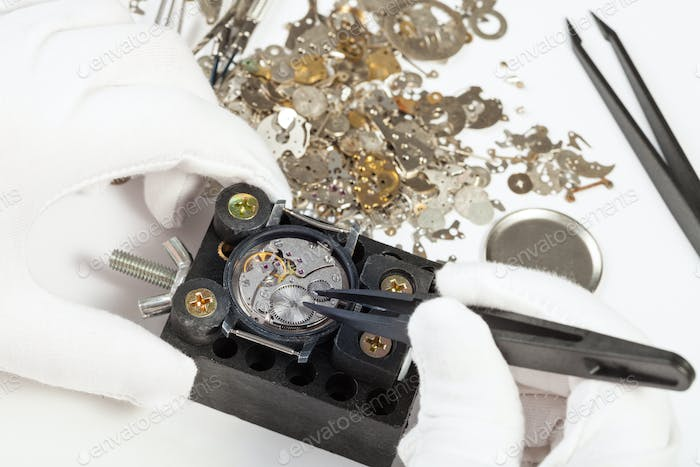 repairing of wristwatch with spare parts