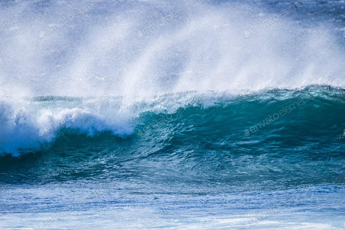 close up of beautiful and bigs blue and green waves breaking