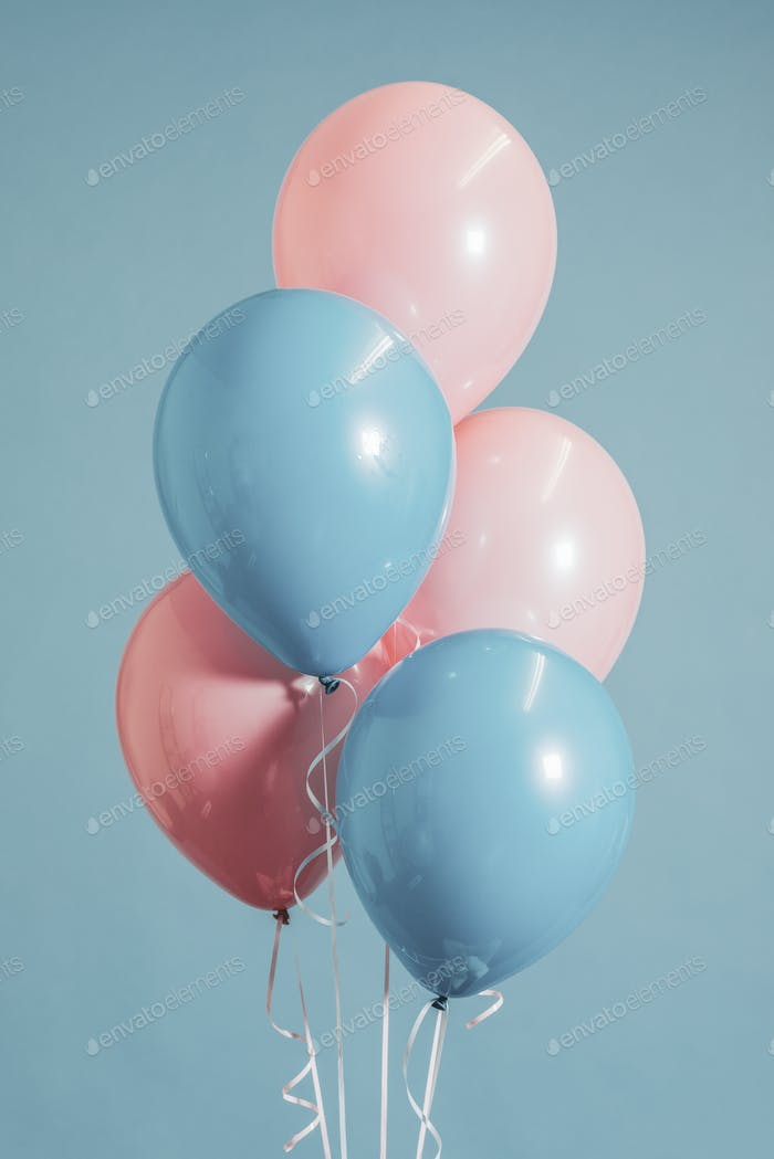 Baby pink and blue balloons