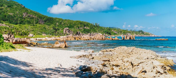 La Digue, Seychelles. Panoramic view of beautiful secluded beach, tropical ocean coastline, unique