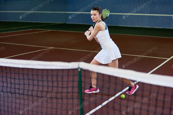 Active Woman Playing Tennis