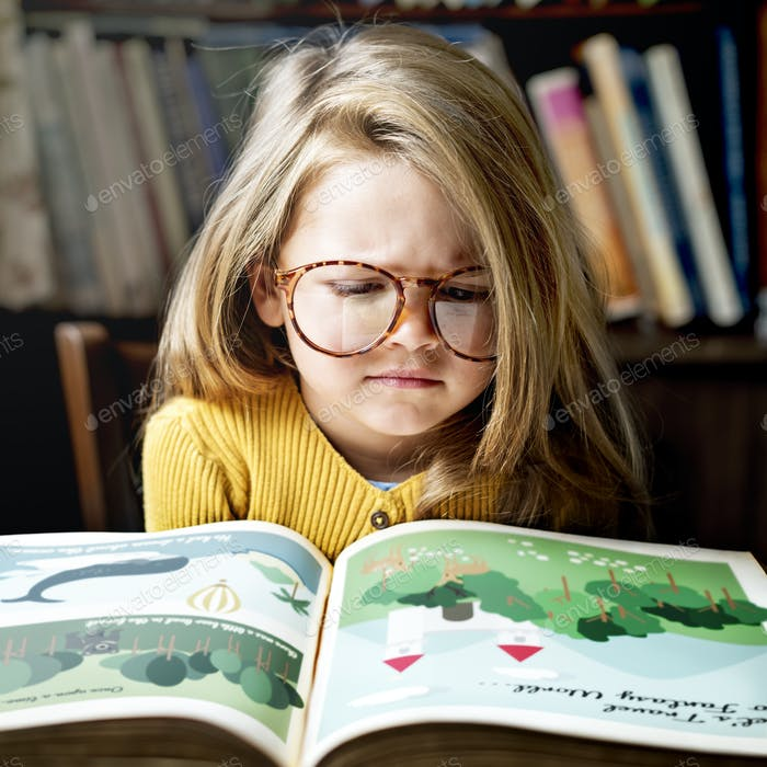 Little girl reading a story