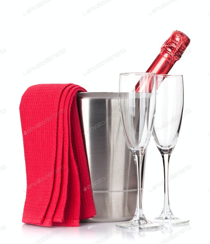 Champagne bottle in ice bucket and glasses