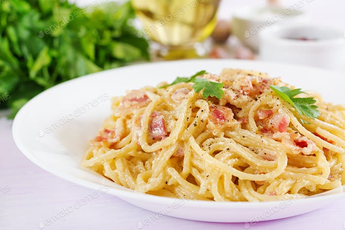 Classic homemade carbonara pasta with pancetta, egg, hard parmesan cheese and cream sauce.