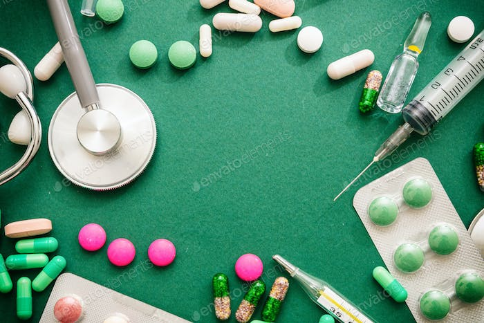 Disease remedy concept. Medical flat lay, green background