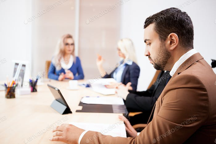Team of business people at meeting in the conference room