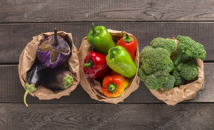 Healthy fresh vegetables in no plastic packages on wood